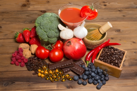 Healthy antioxidants fruits and vegetables on a wooden table