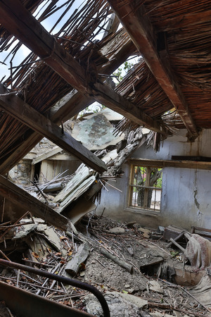 Collapsed roof in an abandoned derelict house in an old village in Bulgaria photo