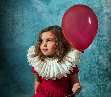 ruff: Vintage girl posing with a victorian ruff collar and a red balloon