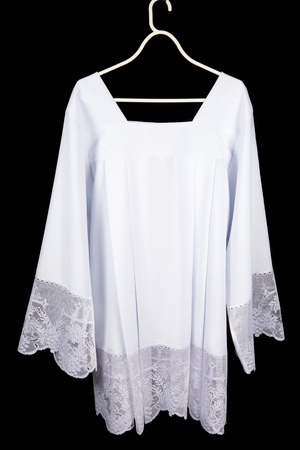 cassock: White lace surplice or chorrock as worn over a cassock by priests, acolytes or choir singers Stock Photo