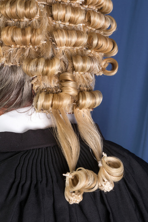 Back look of a lawyer wearing an authentic horsehair wig Stock Photo