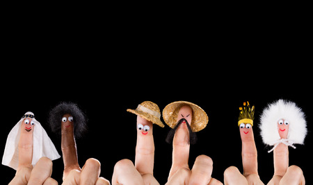 symbolized: Human races and diversity symbolized with isolated finger puppets