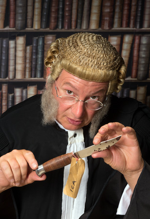 Lawyer in court showing a bloody knife as evidence Stock Photo