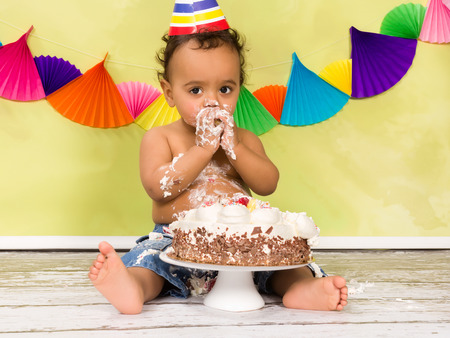 smash: Adorable african baby during a cake smash on his first birthday Stock Photo