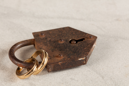 symbolized: Eternal love symbolized by rings in a padlock Stock Photo