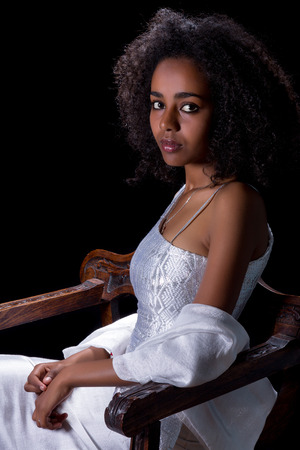 Young Ethiopian woman wearing a white traditional Ethiopian dress photo