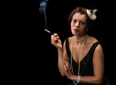 Vintage 1920s lady smoking a cigarette with a mouthpiece photo