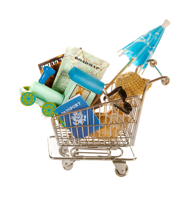 Shopping cart filled with objects for travelling photo