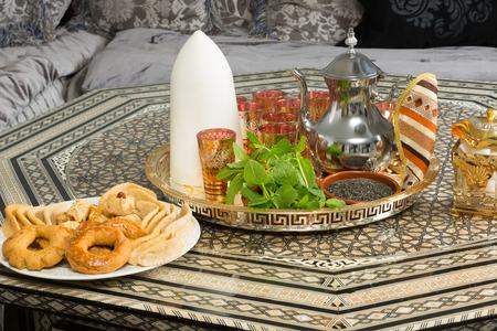 Traditional heavy Moroccan Sugar Cone or Qalib Sukar and tea tray with Ramadan cookies - sugar cones are gifts to mark the birth of babies, weddings or to pay condolences photo