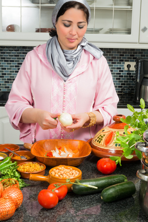moroccan cuisine: Modern European kitchen with ingredients for a traditional tajine dish as prepared by Moroccan immigrant women during Ramadan nights Stock Photo
