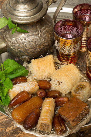 Traditional dates and cookies on a Moroccan tea tray  photo