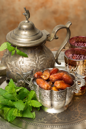 Silver bowl filled with dates as traditional Ramadan treat