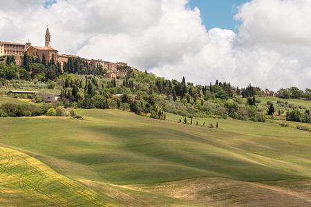 Town of Pienza in Tuscany Italy and the rolling hills of the valley photo