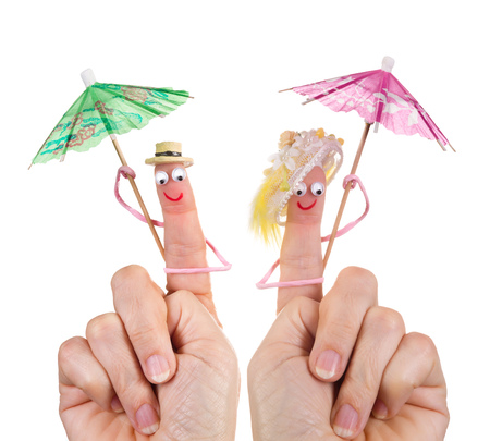 Caricature made of a finger puppet representing a happy couple photo