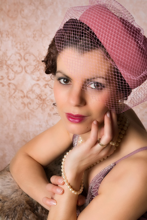 pillbox: Vintage 1920s woman wearing a pink pillbox hat Stock Photo