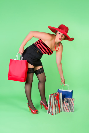 Cheerful pinup girl holding shopping bags photo