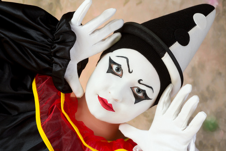 pierrot: Female mime artist in pierrot clown disguise