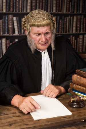 Old judge smiling in court wearing a vintage wig