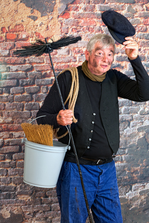 chimney sweep: Friendly chimney sweep saying hello with his cap