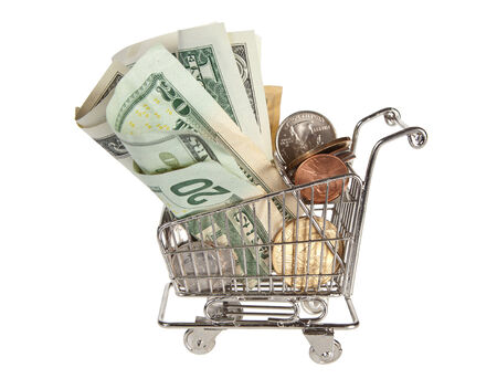 spending full: Little shopping trolley full of money for spending
