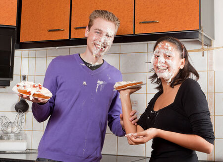 cream pie: Cheerful couple after a funny cream pie fight