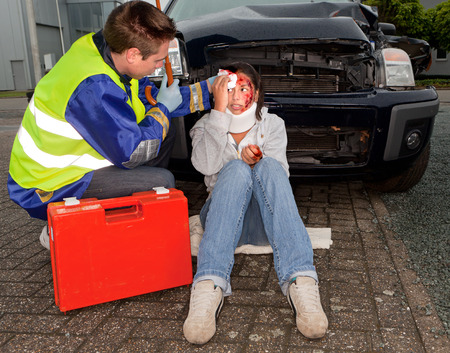 accident car: Paramedic caring for an injured woman after a car accident Stock Photo