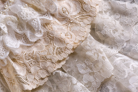 Closeup of white beige and ivory vintage lace fabrics