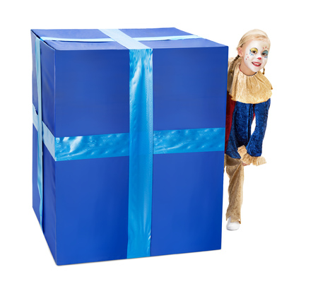 harlequin clown in disguise: Adorable little girl playing peek-a-boo behind a big blue surprise box