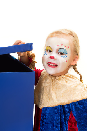 harlequin clown in disguise: Curious clown girl looking into a big blue surprise box
