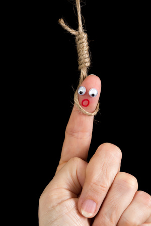 capital punishment: Caricature made of a finger puppet representing death penalty or suicide