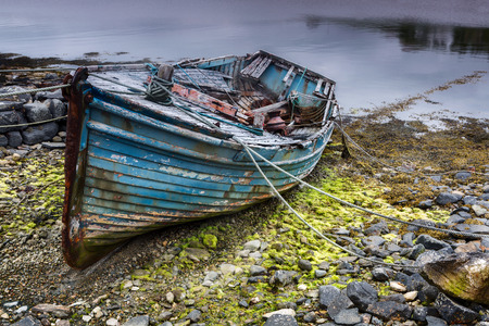 ship wreck: Weathered fishing boat lying on a rocky beach on the Isle of Lewis, Outer Hebrides, Scotland Stock Photo