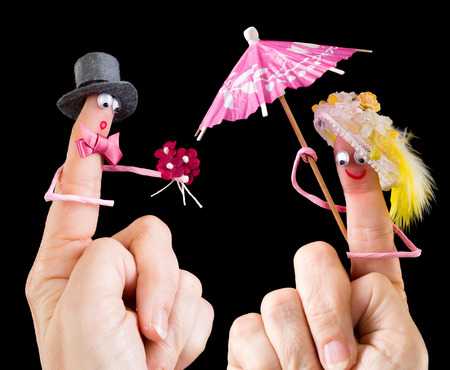puppet woman: Caricature made of a finger puppet representing a valentine couple Stock Photo