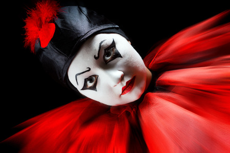 Flashing portrait in red and black of a mime pierrot clown photo