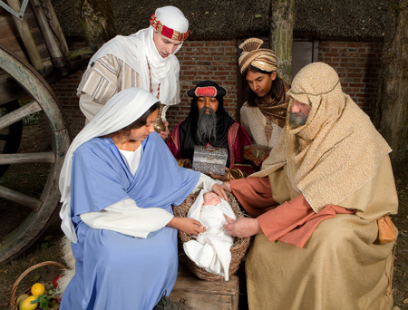 Live Christmas nativity scene reenacted in a medieval barn Stock Photo