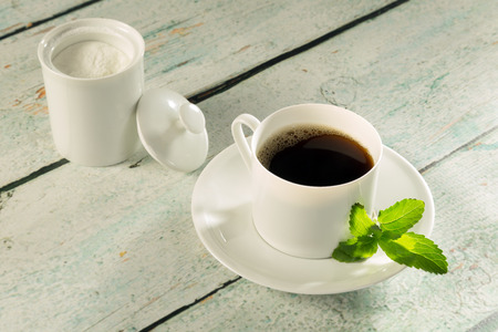 sweetening: Herbal sweetener stevia in powder form and a cup of coffee