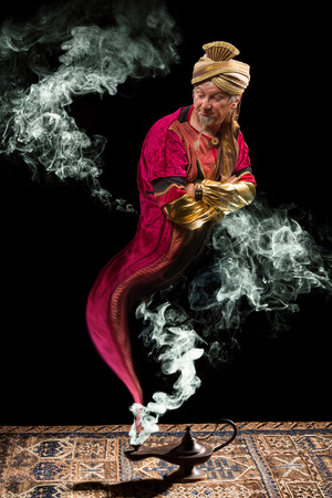 oil lamp: Fantasy genie with turban coming out of aladdins oil lamp Stock Photo