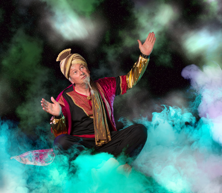 genie: Arabian Genie floating on clouds and bringing treasures and fortune Stock Photo