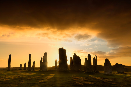 Megalithic stone circle of 3000 bc on the Isle of Lewis and Harris, Outer Hebrides, Scotland, silhouette at sunset Stock Photo