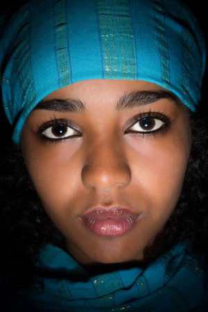 africa: Young Ethiopian woman wearing a blue scarf Stock Photo