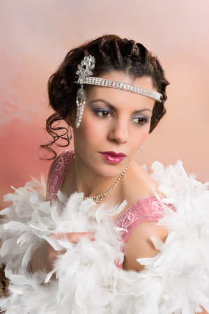 feather boa: Beautiful vintage 1920s lady wearing a headband and white feather boa