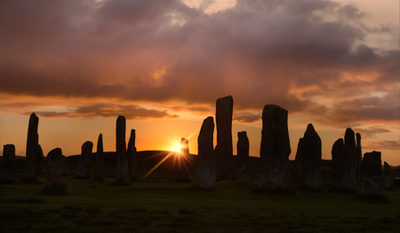 standing stones: Megalithic stone circle of 3000 bc on the Isle of Lewis and Harris, Outer Hebrides, Scotland, silhouette at sunset Stock Photo