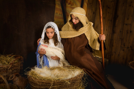 mother father baby: Christmas nativity scene reenacted by children and a doll Stock Photo