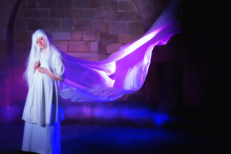 White haired ghost in a castle with her dress in the wind