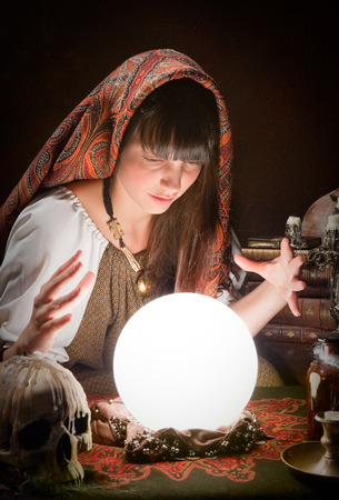 Fortune-teller using a crystal ball to predict the future photo