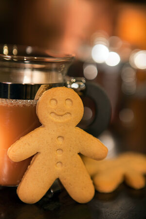 Gingerbread men cookie biscuits with hot coffee photo