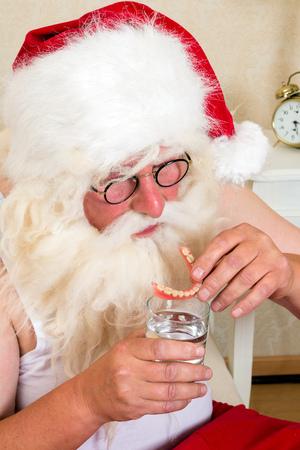 false teeth: Morning ritual of Santa Claus, putting his false teeth in