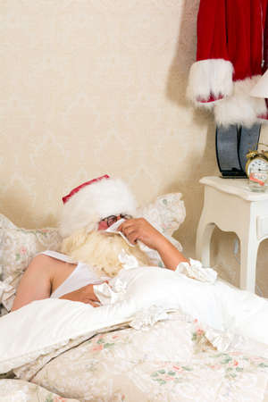 handkerchiefs: Poor santa claus in bed with the flu or a cold Stock Photo