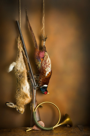 Hunting still life with hare and pheasant in old master painting style
