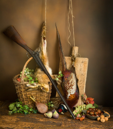 hunting rifle: Classic still life with dead pheasant and hare combined with autumn fruits and hunting rifle Stock Photo