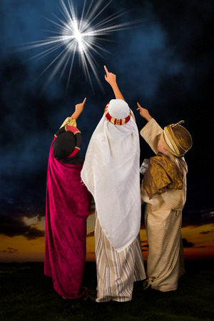 bethlehem christmas: Wisemen played by three girls in a live Christmas nativity scene